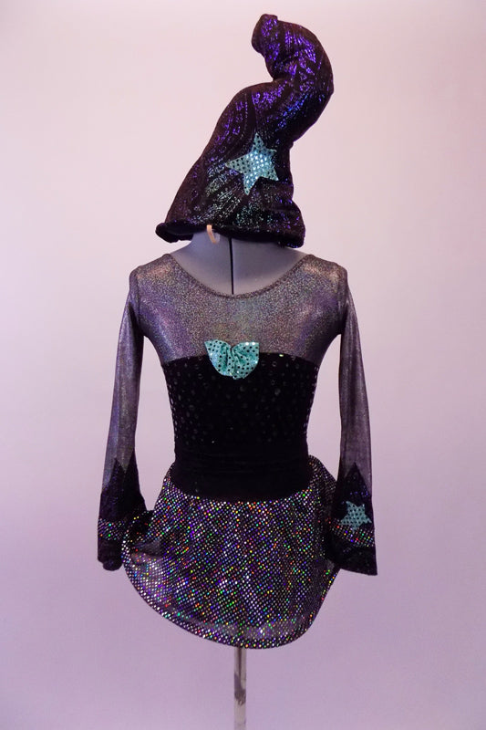 Iridescent silver dress has long sleeves and a black velvet polka dot torso. The skirt has a looping tubular edge. The green star and purple swirl accent and details give this costume a little extra pizazz. Comes with a black and purple swirled sorcerer's hat with green star detail. Front
