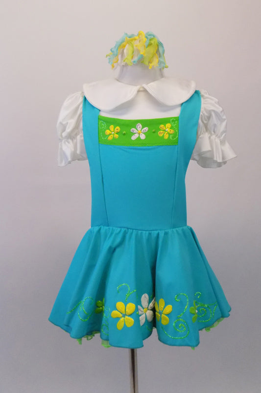 Pinafore style white aqua dress has hand painted white, yellow and green flowers, pouffe sleeves and Peter Pan collared blouse style. The tricot ruffled petticoat is green and accents the pinafore and flowers. Comes with matching curly hair accessory. Front