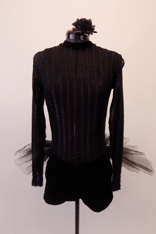 Black high neck, long sleeved short unitard has a sheer striped pattern torso & velvet bottom. A black bra top sits beneath the leotard but can be worn with sticky cups with open back. The tulle tutu style bustle skirt gives a costume a unique twist. Comes with a floral hair accessory. Front