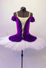 Purple velvet and white ballet bodice with attached overlay has off-shoulder pouffe sleeves and a white and gold center inlay with pearl accent. The attached overlay is an open-front peplum that can be tacked onto a tutu. Front