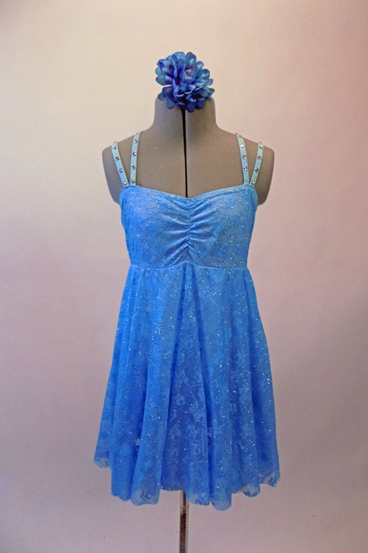 Pretty blue sequined sheer lace costume has an empire waist and gathered bust. The crystal covered double straps cross over at the back and provide a bit of bling. Comes with a floral hair accessory. Front