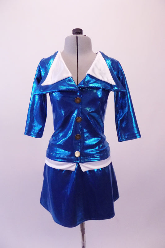 An airline themed two-piece costume is a metallic turquoise blazer with wide double white lapel collar and waistband with brass buttons. The matching pull-on skirt has side slits. Front
