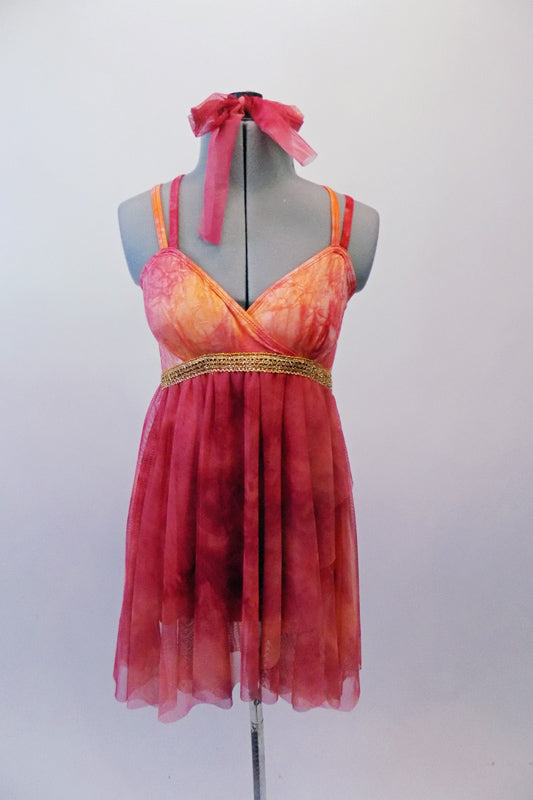 Marbled red and burnt orange coloured dress has an Empire waist with thick gold banding and crossover bust. The double thin straps cross over at back. The sheer flowing chiffon skirt falls just above the knee. Comes with matching hair tie. Front