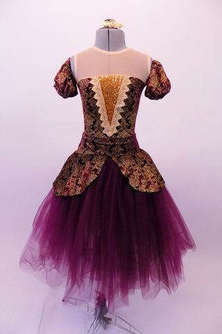 Stunning baroque style ballet dress is a burgundy base with gold brocade print & sheer nude illusion neckline above inlay pop. The matching pull-on peplum overlay with a wide waistband sits over top of a burgundy tulle romantic tutu skirt. The low scoop back and separate pull-on pouffe sleeves finish the look. Front