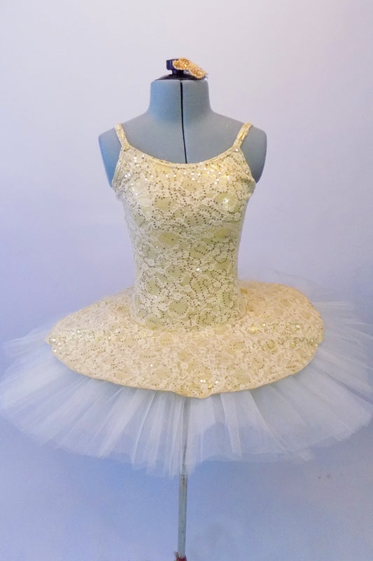 Ivory pleated six-layer platter tutu has a gorgeous creamy gold beaded lace attached bodice and overlay. Comes with a floral hair accessory. Front
