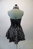 Black halter style dress has prominent silver swirled vine pattern. The neck has a large black bowtie from which cascades a large tulle layered ascot/bib. Comes with a black bowler hat. Back