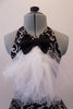 Black halter style dress has prominent silver swirled vine pattern. The neck has a large black bowtie from which cascades a large tulle layered ascot/bib. Comes with a black bowler hat. Front zoomed