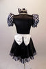 Sweet black dress has black and white striped pouffe sleeves and wide white waistband with large bow at back. The attached skirt has a black and white striped ruffle and a large pink sequined heart.  Comes with matching black and white striped hair bow. Back