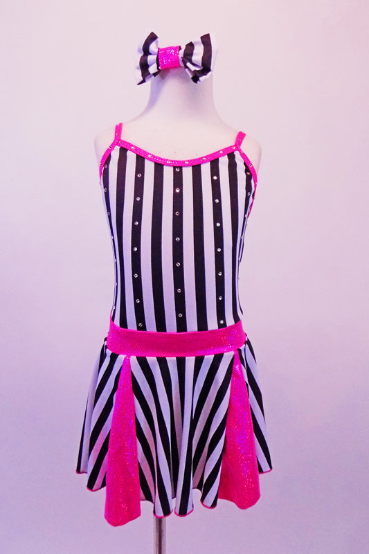 Sweet black and white vertical striped dress had bright pink inlays in the skirt, a pink waistband and crystal crystal-lined, pink binding. The front of the dress is lined with Swarovski crystals as are the triple back straps. Comes with matching striped hair bow and pink gauntlets. Front