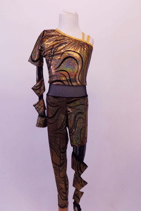 Gold and black swirled iridescent unitard has black sheet midriff and single shoulder with one long sleeve. The left leg and right sleeve are sheer black mesh with attached tube-like matching fabric twists. Clear straps support the other shoulder. Front