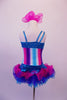 Costume has turquoise, crystal lined neckline with asymmetrical shoulder and straps with an adorable curly ruffled attached skirt in shades of blue pink and purple. The colours of the skirt compliment the striped vertical torso and the large pink hair accessory. Back