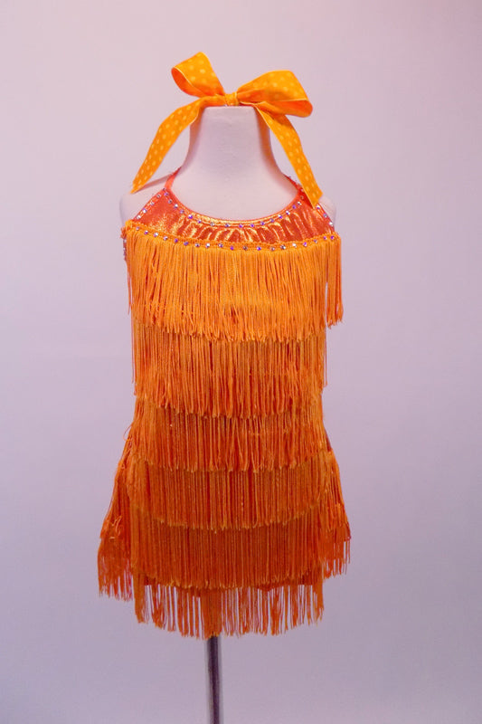 Orange fully fringed dress has crystalled neckline and tie-up halter collar. The deep low back has a wide mesh crystal lined horizontal band. Front