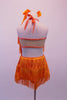 Orange fully fringed dress has crystalled neckline and tie-up halter collar. The deep low back has a wide mesh crystal lined horizontal band. Back
