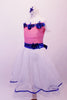 Romantic style ballet dress has pink glitter bodice with white crystal lined bust and cap sleeves. The bust and waist are embossed with royal blue 3-D sequined floral applique and large back bow. The attached white skirt is crystal-tulle with petticoat and trimmed with royal blue ribbon. Comes with a hair accessory. Side