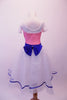 Romantic style ballet dress has pink glitter bodice with white crystal lined bust and cap sleeves. The bust and waist are embossed with royal blue 3-D sequined floral applique and large back bow. The attached white skirt is crystal-tulle with petticoat and trimmed with royal blue ribbon. Comes with a hair accessory. Back