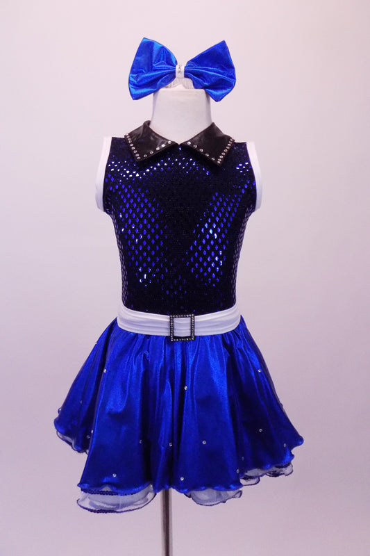 Blue-black costume has a diamond sequin bust with white trim open back and black leatherette crystalled collar. The attached blue skirt with crystal scattered organza overlay has a white belt with crystal buckle. Front