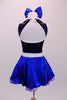 Blue-black costume has a diamond sequin bust with white trim open back and black leatherette crystalled collar. The attached blue skirt with crystal scattered organza overlay has a white belt with crystal buckle. Back