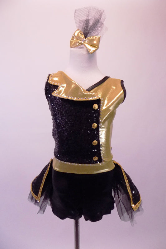Black sequin & gold big band inspired short unitard has wrap front with gold accent side buttons & a crystal lined fold down lapel collar. The two sides of gold & black come together at the centre open back with a crystal ring buckle & attached back crystal bustle skirt with gold braiding & tulle. Comes with gold bow. Front