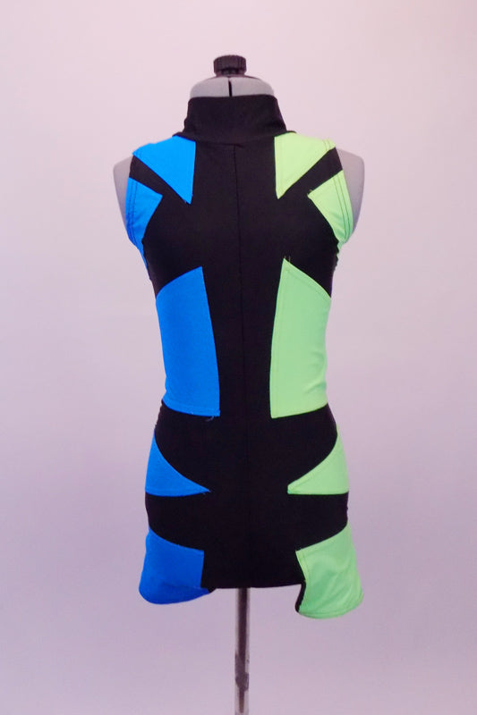 Futuristic short unitard has a turquoise right side and a pale green left side. The two sides are divided by an intricate geometric pattern of black that is a mirror image at the front and zip-close back. Gives the appearance of a mirror or silhouette. Front