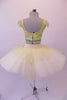 Professional pleated & hand tacked, 9-layer pancake tutu is two-piece. The tutu has an ivory basque & gold crystal tulle overlay with sequin accents & appliqued flowers. The bodice is a crop style top with pearl beaded fringe, gold & green sequined, applique floral lace & scalloped cap sleeves. Comes with hair flower. Back