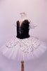 Pleated, hand tacked pancake tutu is a beautiful contrast of black & white. The tutu is scattered with crystals & has a silver sequined overlay. The black velvet bodice has a deep sweetheart cut with nude mesh centre & hand painted silver branch design. Comes with white tulle armbands and crystal hair barrette. Left side