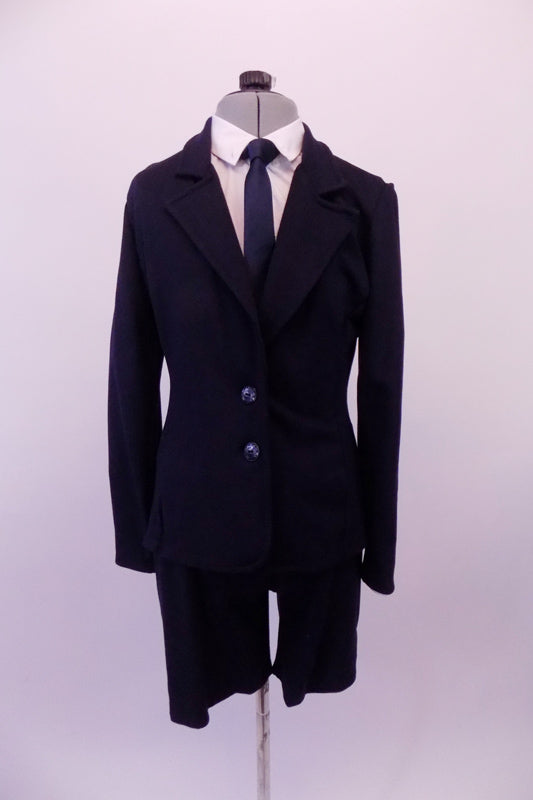 Dress suit style costume is a thick stretchable navy blue knit. It comes with thick a button front, tapered blazer with full lapels and matching pant-style zipper front shorts. The white long-sleeved shirt and navy blue tie complete the professional business look. Front