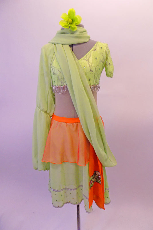 3-piece costume has a traditional taste of India with a Bollywood feel. Pale green beaded lace covered half-top has cap sleeves & beaded scallop trim. It is complemented by a single Bishop-sleeved half-shrug that extends into a long wrap scarf. The matching skirt has orange peplum overskirt with a beaded kerchief. Front