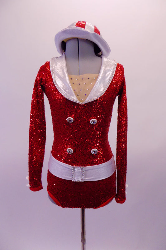 Bold, bright red fully sequined long-sleeved leotard had white lapel collar & belt with crystal buckle accent. The front has crystal accents & four large crystalled buttons on the torso. The back is a large open keyhole style and the costume is completed by a red and white sequined striped hat. Front