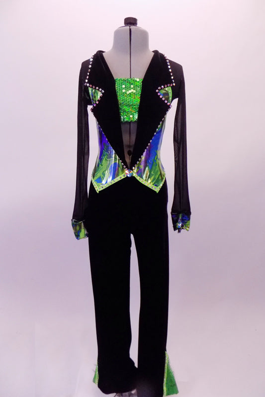 Black based full unitard has green sequined triangle leg accents to match the green sequined bandeau bust. The blazer style top has wide lapel collar lined in large crystals that open to reveal the green bandeau. The body of the jacket has a metallic marbling of blues & greens that match the cuffs of the sheer sleeves. Front