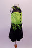 Back and lime green sequined costume has faux sweetheart bust with a black mesh upper and a green and black polka dot collar that matches the waistband and large bow accent. The back is open with corset style straps that hold the torso together. The attached black skirt completes the look. Comes with polka dot gauntlet and hair accessory. Side