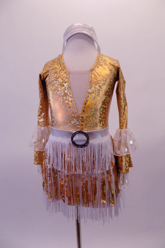Gold leotard has a deep plunge V-front with nude mesh insert lined entirely with crystals. The long sleeves have alternating ruffled layers of white- silver polka dot and gold. The attached skirt is layers of white fringe over gold with a silver waistband that has a crystal buckle accent. Comes with a silver headband. Front