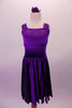 Stretch satin tank style purple dress has a wide shoulder strap. The bodice has a series of colour matched crystals in a large triangular shape and along the straps. Comes with matching floral hair accessory. Front