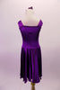 Stretch satin tank style purple dress has a wide shoulder strap. The bodice has a series of colour matched crystals in a large triangular shape and along the straps. Comes with matching floral hair accessory. Back