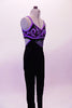 Black velvet full unitard has purple piping to match the intricate purple-silver hand painted design on the bust and down the entire left leg. The entire purple piped area is covered with Swarovski crystals. Comes with crystal hair barrette. Right side