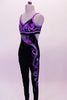 Black velvet full unitard has purple piping to match the intricate purple-silver hand painted design on the bust and down the entire left leg. The entire purple piped area is covered with Swarovski crystals. Comes with crystal hair barrette. Left side