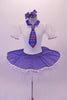 Cute white pancake tutu has a white velvet bodice with pouffe sleeves and blue collar. The skirt overlay is a denim with lace edging that matches the tartan tie. Comes with blue hair bow accessory. Front