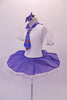 Cute white pancake tutu has a white velvet bodice with pouffe sleeves and blue collar. The skirt overlay is a denim with lace edging that matches the tartan tie. Comes with blue hair bow accessory. Side