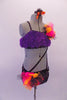 2-piece costume is attached by two crystal covered straps that extend from below the left bust across the front of the torso. The costume is a black base with colourful holographic dotted pattern. The brief has crystalled waistband & an orange-pink tulle accent at hip & the bust of the purple fur covered strappy bra. Right side