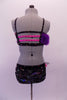 2-piece costume is attached by two crystal covered straps that extend from below the left bust across the front of the torso. The costume is a black base with colourful holographic dotted pattern. The brief has crystalled waistband & an orange-pink tulle accent at hip & the bust of the purple fur covered strappy bra. Back