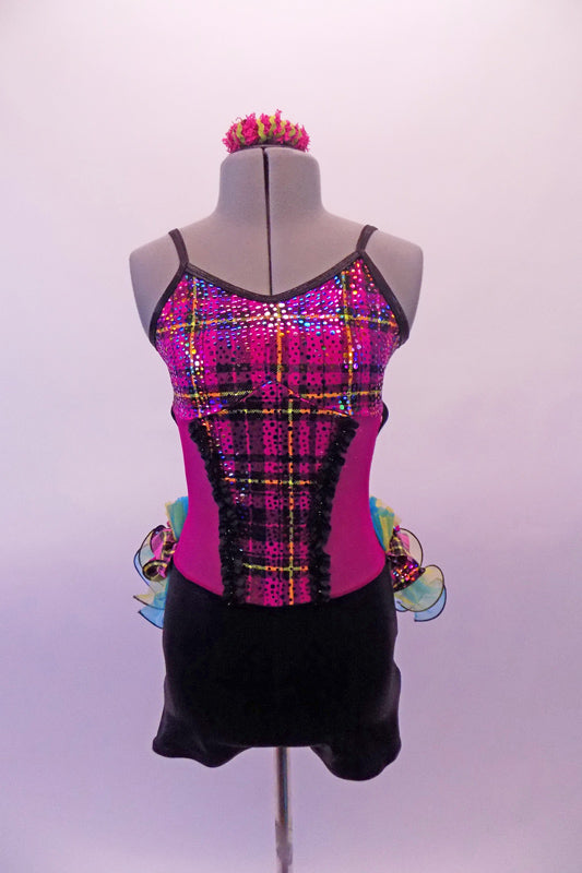 Short unitard has a black bottom and the top is fuchsia with a colourful tartan bust and torso section edged with black lace. The attached back bustle is comprised of layers of yellow and turquoise organza curly ruffle and layers of gathered tartan and organza. Comes with matching hair accessory.  Front