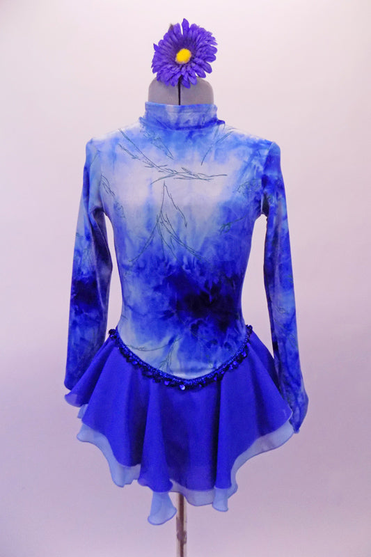 Velvet skate costume has high collar neck, long sleeves & zip back. The soft blue & white pattern of the top is a marbled effect with floating green branch designs throughout. The princess cut waist is lined with blue sequins. The skirt is a softened royal and pale blue chiffon. Comes with a floral hair accessory. Front