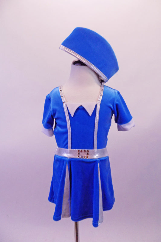 Flight attendant style costume is a short-sleeved bright blue velvet with silver banding, waistband and pleats. The deep V back is held by a horizontal crystalled strap.  Comes with a matching blue velvet attendant hat. Front