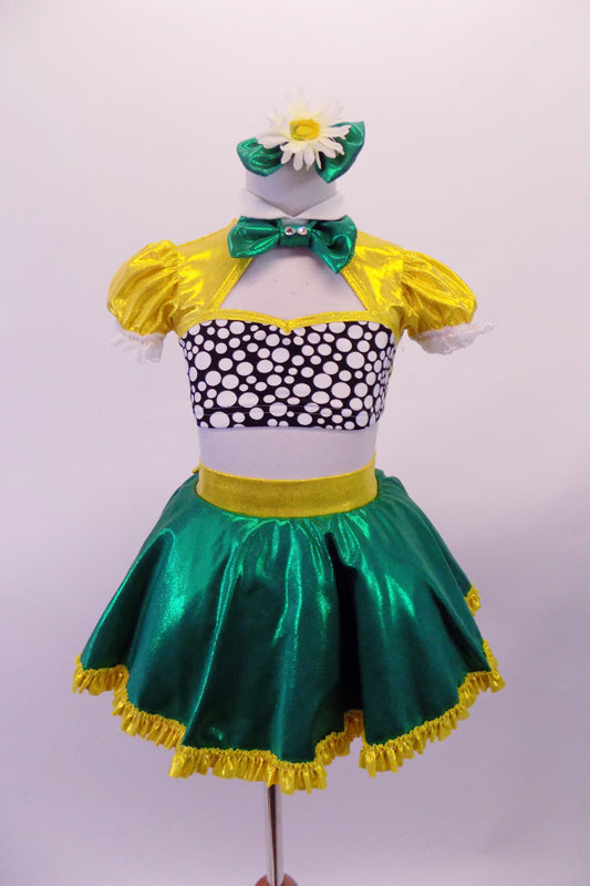 2-piece costume is a yellow pouffe sleeved half top with Peter Pan collar, black & white spotted bust & green banding along the large keyhole back. The green skirt has a yellow waistband that becomes a large bow at the back & a yellow ruffle trim. Comes with yellow gauntlets a floral hair accessory & green bow tie. Front