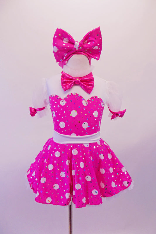 Sweet hot pink and white, sparkly polka dot dress has scalloped white upper bust and shoulder with bow accented pouffe sleeves. The open circle back has a large white bow at the base originating from the white waistband Comes with a matching large polka dot hair bow and pink tap shoe bows. Front