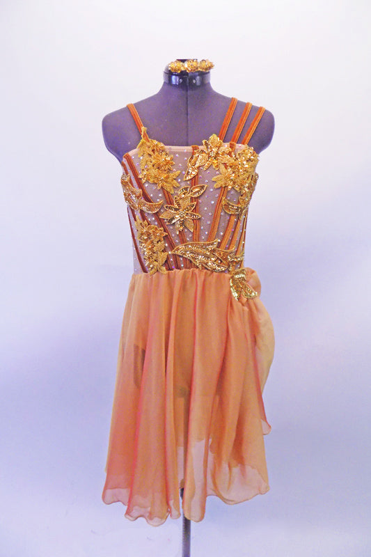 Nude mesh torso of this lovely lyrical costume has copper vertical bands & large gold floral & leaf appliques with scattered crystal accents. The left shoulder has a single strap while the right has a triple strap. The attached chiffon skirt is a coral/gold knee-length with a pick-up at the appliqued left hip. Front