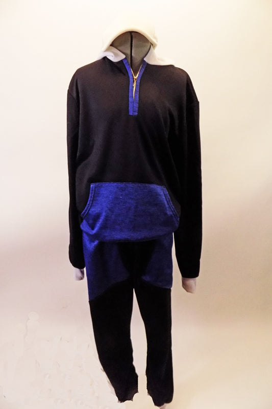 Two-piece hip-hop costume has a black fleece hoodie with blue pock front, zipper accent and a white hood lined with blue. The matching black fleece drop-crotch harem has large blue wrap-style pockets. Front