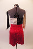 Crushed velvet tri-coloured skirt dress has a halter neck and wide leg short bottom. The left bust is white and right is black, both with sparkle accents. The body and bottom are red and pops the black and white. Comes with black and white gauntlets and floral hair accessory. Back