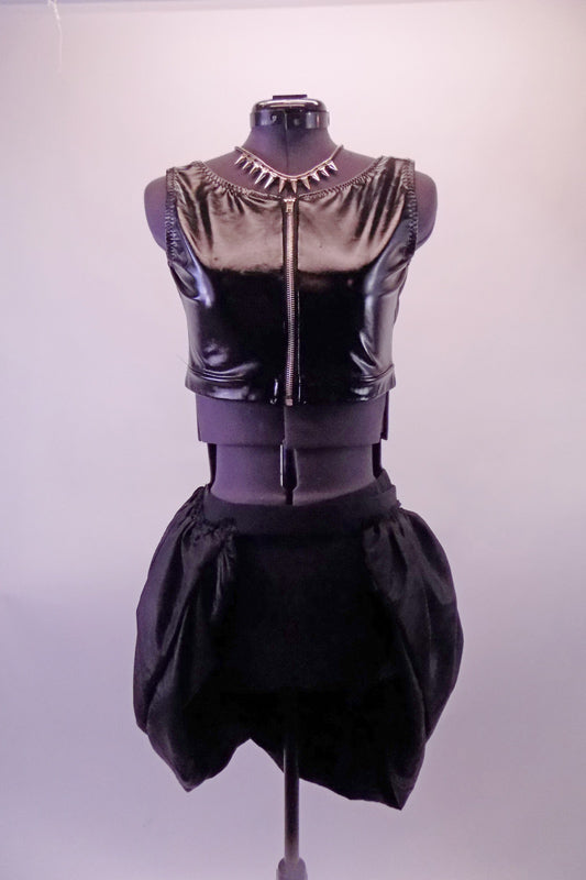 Black leatherette vest/half-top has a zip front. The bottom is shorts with an attached overlapping bubble pouffe bustle skirt. Comes with a spiked necklace accessory. Front