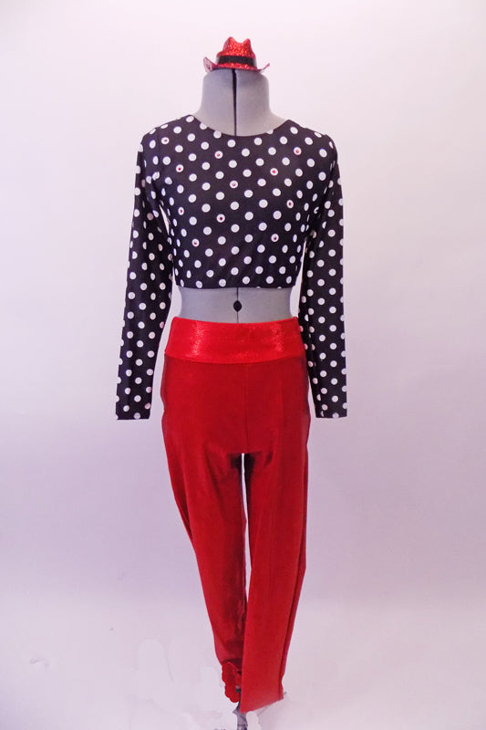 Bright red shiny leggings have large black crystalled back pockets to add some pizzazz. The black and white polka dot half-top has round scoop-neck front, long sleeves and wide bands that cross-over to create the back. Comes with glittery red hat accessory. Front