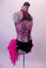 Fuchsia and black leotard has a pink animal print torso with faux corset detail and sweetheart bust lined entirely with crystals. The upper chest is a sheer black mesh with fuchsia collar.  The bustle gives the costume its biggest pop. It is comprised of layers of hot pink boa feathers. Comes with a floral hair accessory. Side